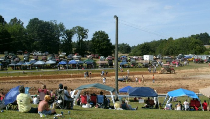 Holly Gray state park and the truck waiting to race and the fans in the sun