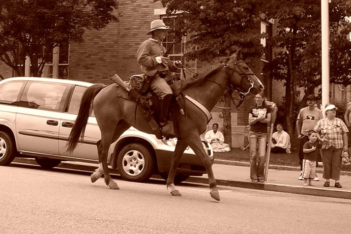 Ed WaltZ riding Jasper down main street