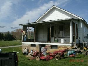 Tom removing old back porch
