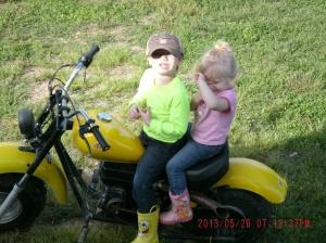 Christopher and Paige sitting on Codys mini bike