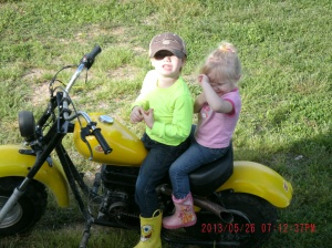 Christopher and Paige sitting on Codys mini bike