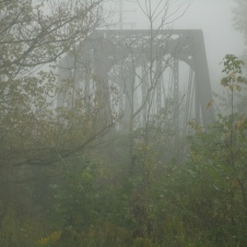 Iron train bridge in foggy Lewis County West Virginia