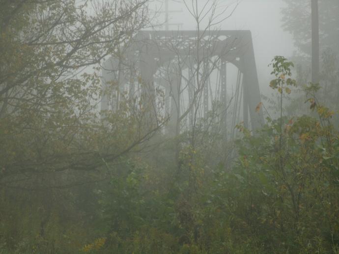 Iron train bridge in foggy Lewis County West Virginia
