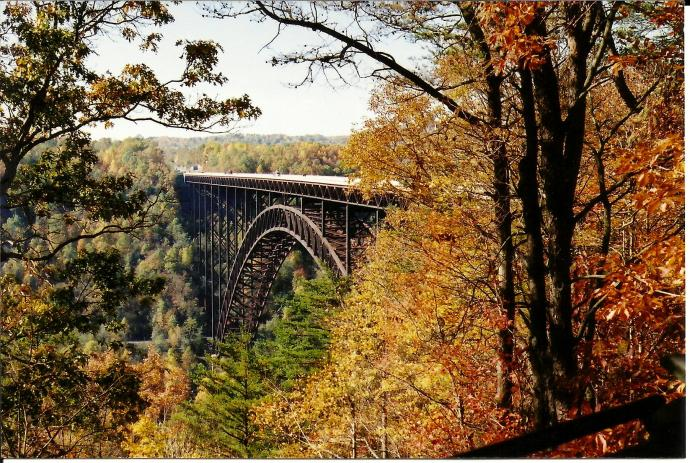 New River Gorge Bridge with fall folage 2000 by jolynn powers