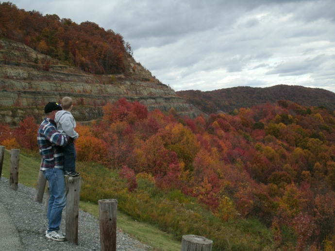Fall folage on hwy 19 in Fayette county West Virginia ...Tom holding Christopher