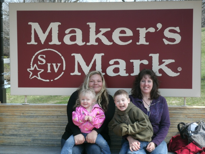 Maker Mark distillery sign with kids
