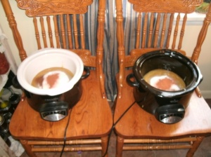 two slow cookers 1/2 full of apple butter ingredants