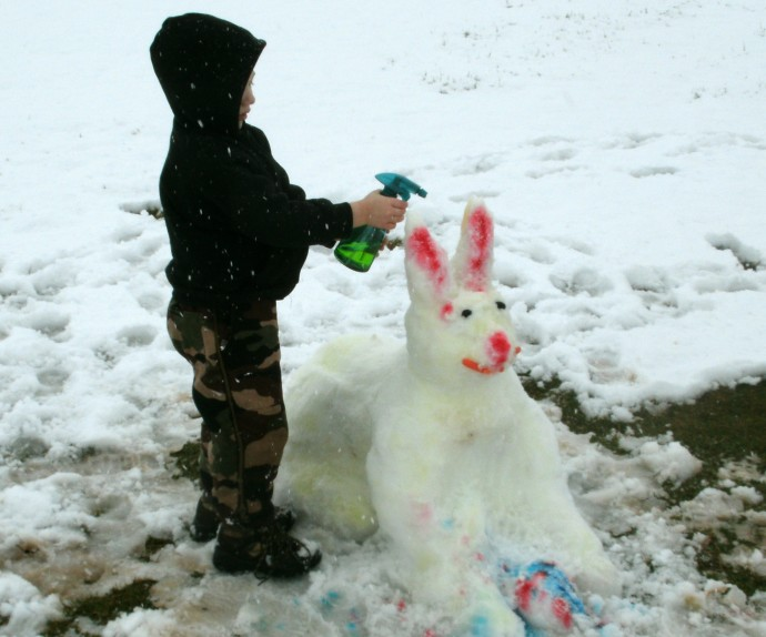Christopher painting his snow bunny