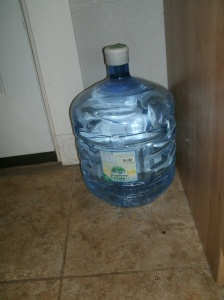 4 gallons of water in a storage safe bottle