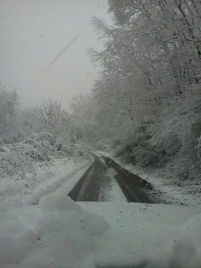 snow covered road by Jeff Cook.