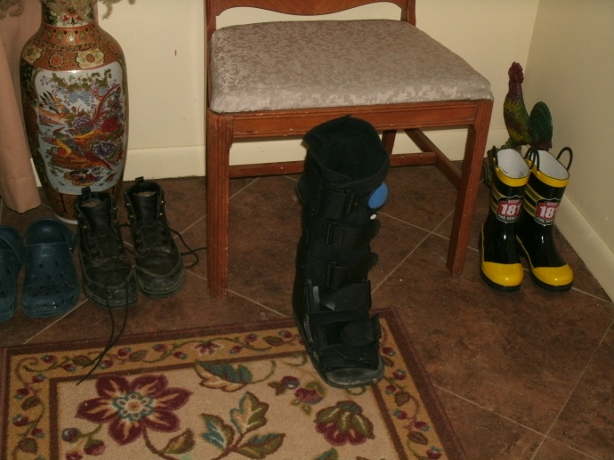 my air cast boot in the entry area with other shoes