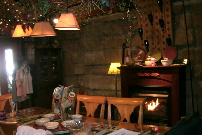 Dinning table with fire place at Lambert's Vintage wines, Weston, West Virginia