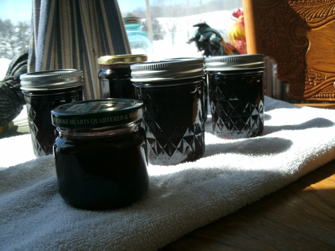 small jars of organic cherry jelly