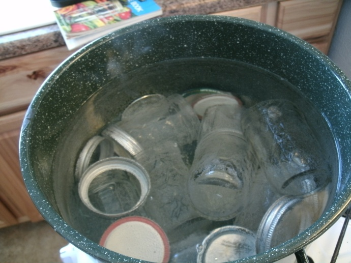 boiling water bath full of jars lids and rings