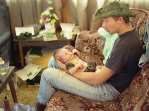 Tom Powers holding week old Cody Powers