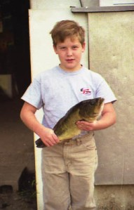 Cody Holding small mouth bass age 7