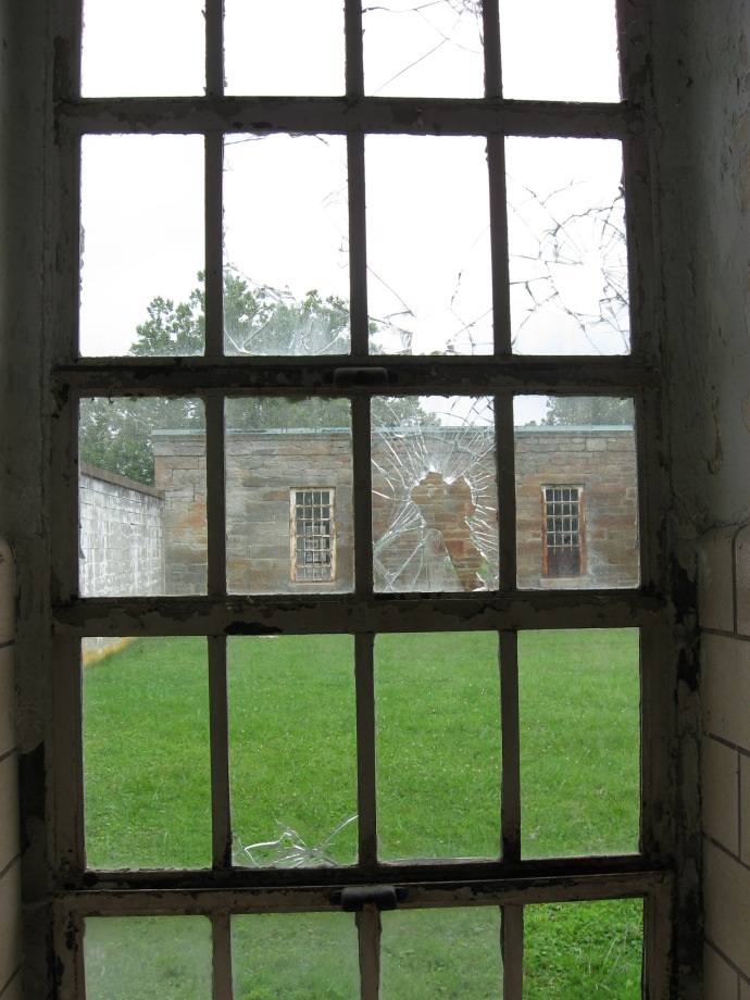 window looking out into court yard of the civil war section of the hospital