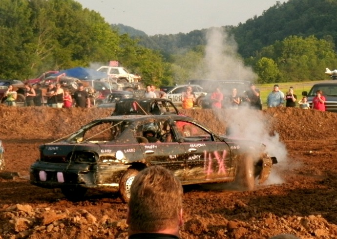 smoke pouring out of a Demolishen Derby car