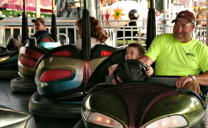 Powers family on the bumper cars at the LC fair 2014