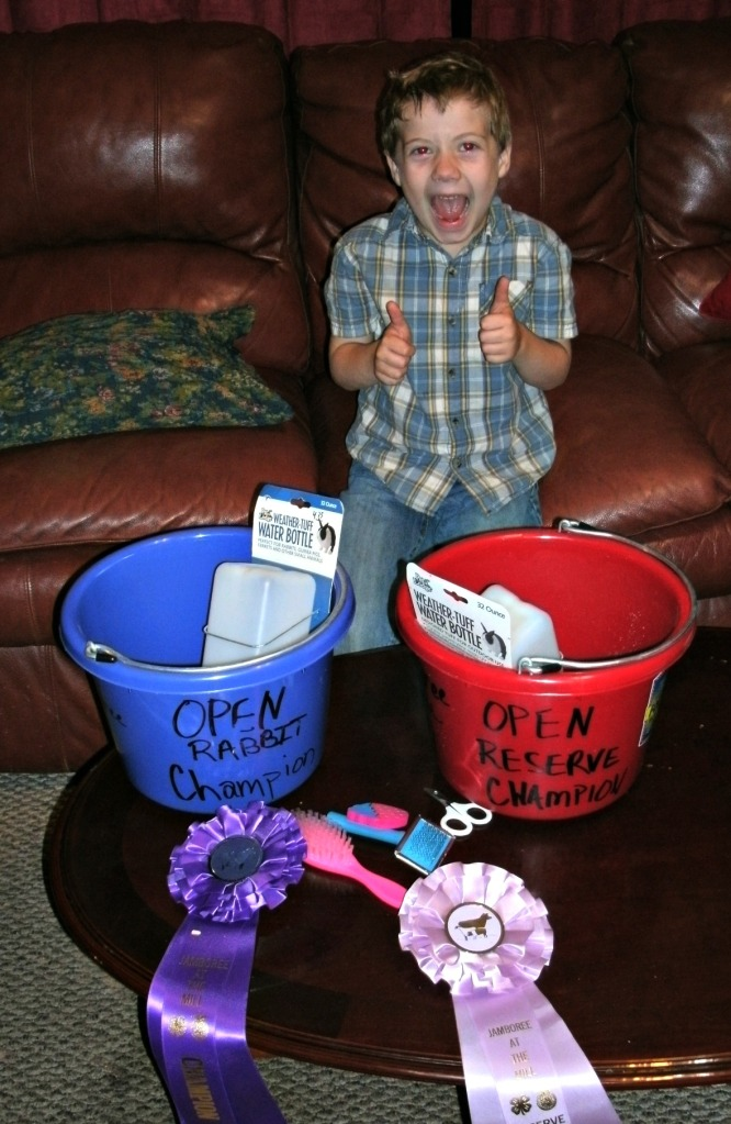 Christopher with ribbons and prizes from the 2014 4-H jamboree