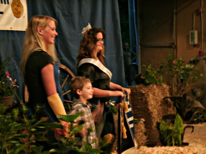 Christopher getting his picture taken with the fair Queen and the judge