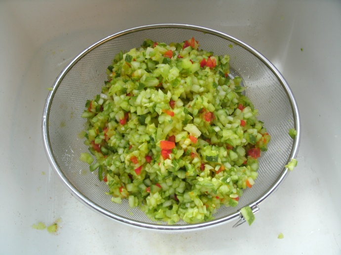 draining pickle relish in strainer
