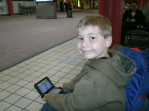 Christopher playing a game at Pittsburgh airport