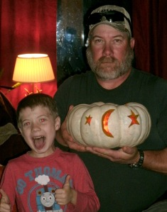 Tom and Christopher with a home grown Jack-o-Lantern