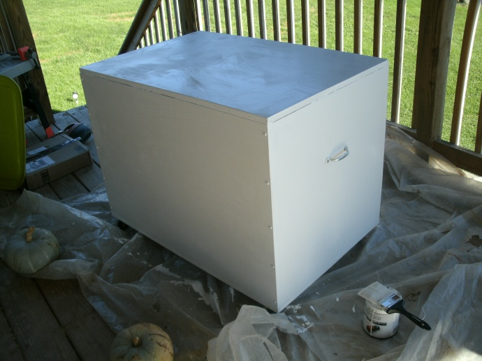 white toy box freshly painted