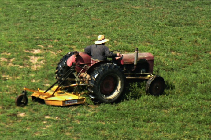Jim Devricks, Mowing his hay fields.