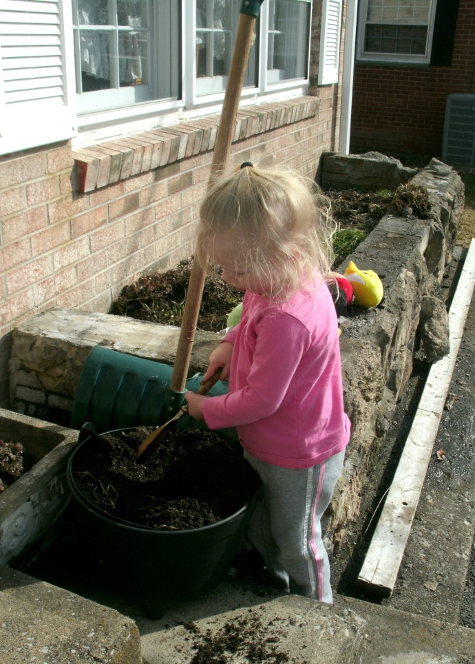 Paige digging flower pot on porch