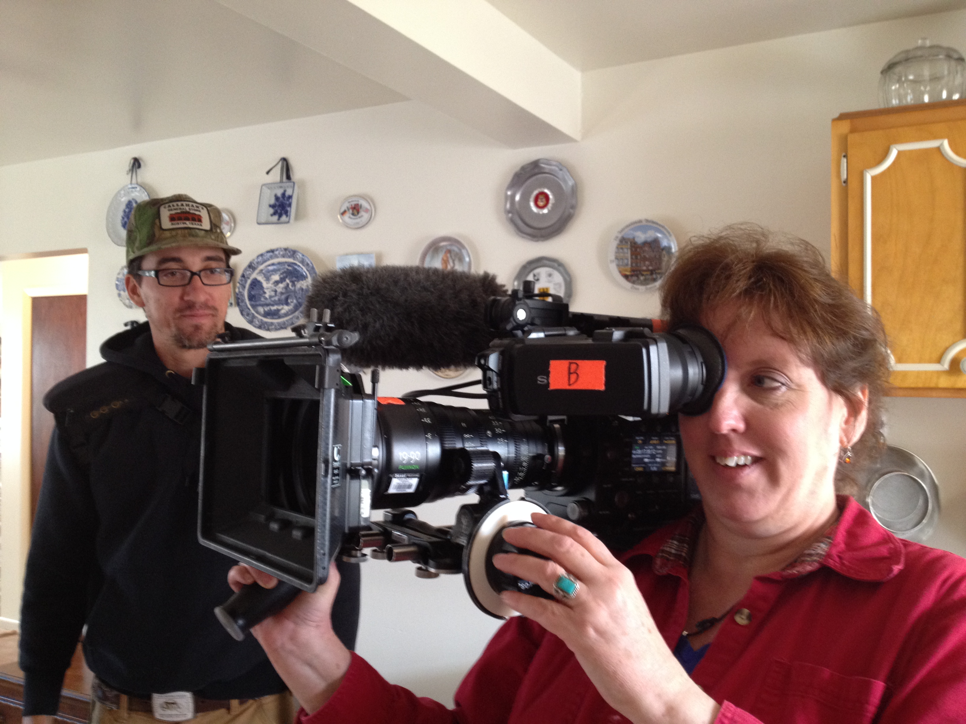 Jolynn holding television camera in my kitchen