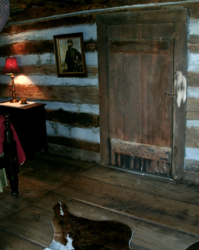 "Front door of cabin with photo of Gen. Thomas ""Stone Wall"" Jackson"