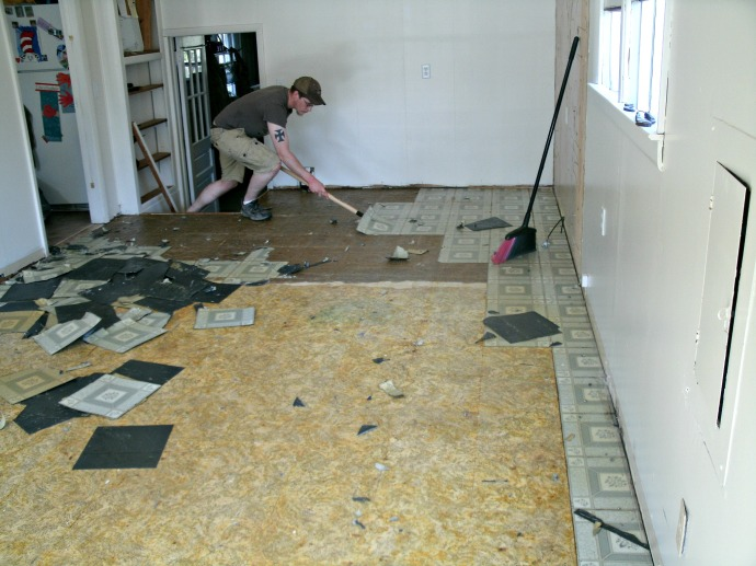 Cody Power stripping old floor tiles