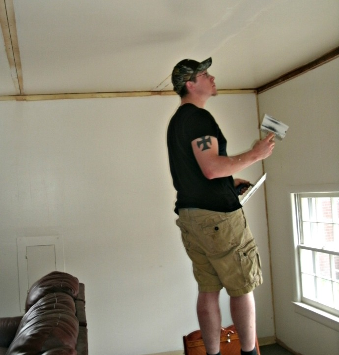 Cody Powers doing mud and tap repairs to the ceiling