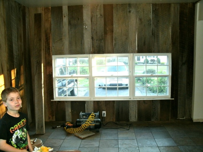 Barn wood about finished on wall with windows