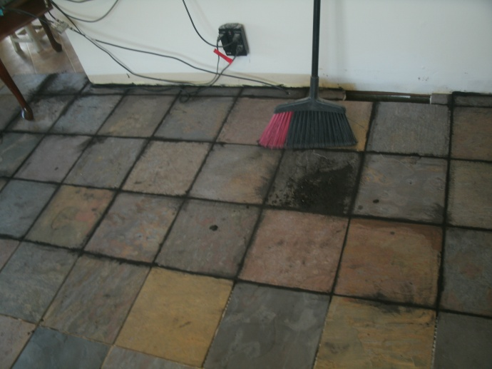 After using a grout bag I sweep up the lose grout before washing the tiles