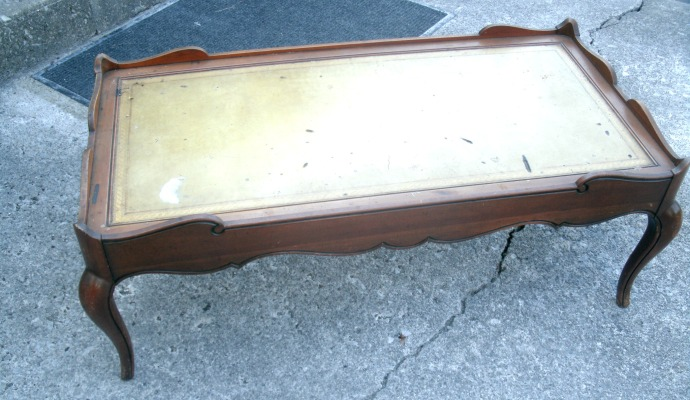 side view of damaged coffee table