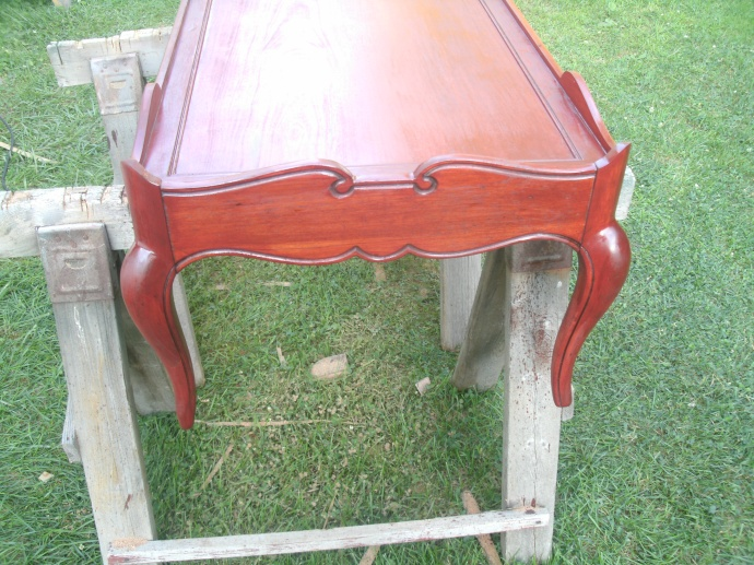 red orange color of the first coat of stain.