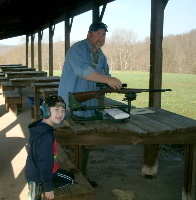 Tom Powers teaching Christopher Powers about gun safty