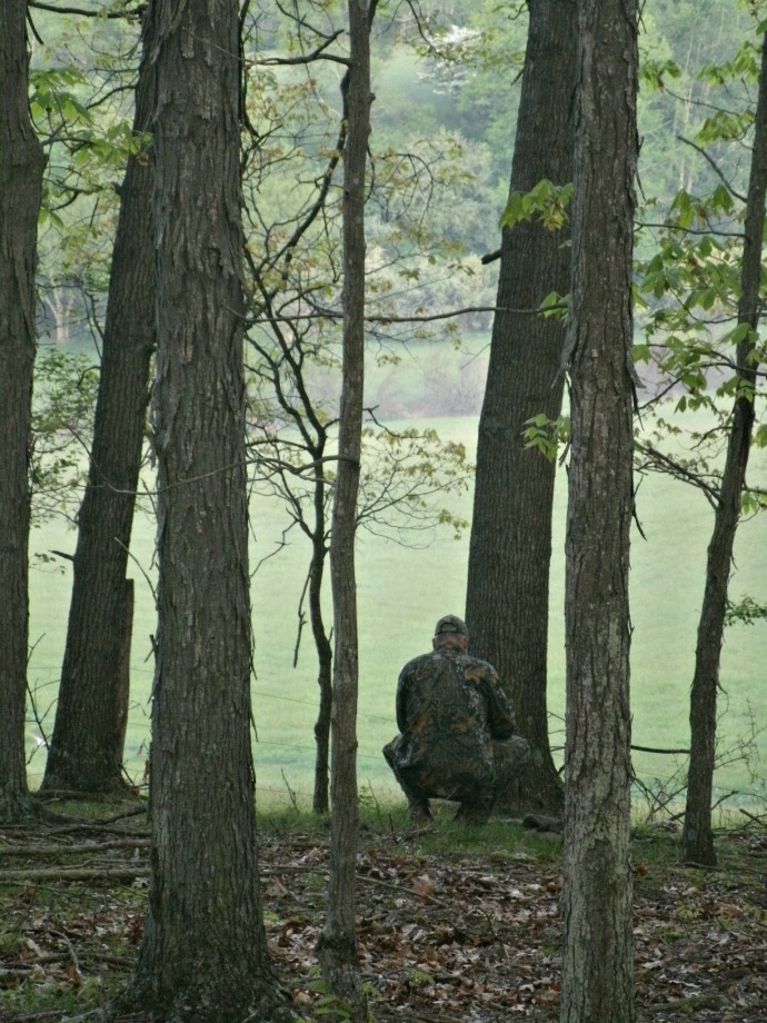 Tom blending into the tree line as we turkey hunt