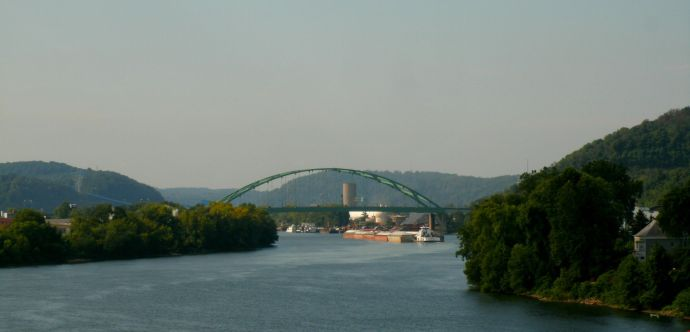 Barge moving slowly up the Ohio River from Wheeling to Wirton West Virginia