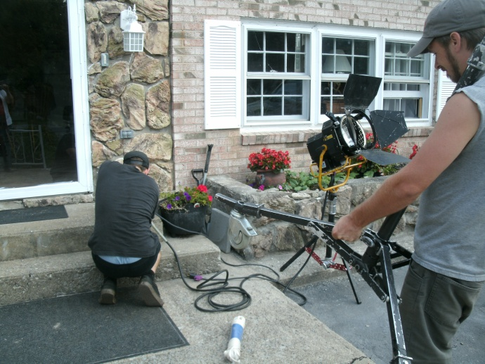 Travis director of photography setting up on last day of filming