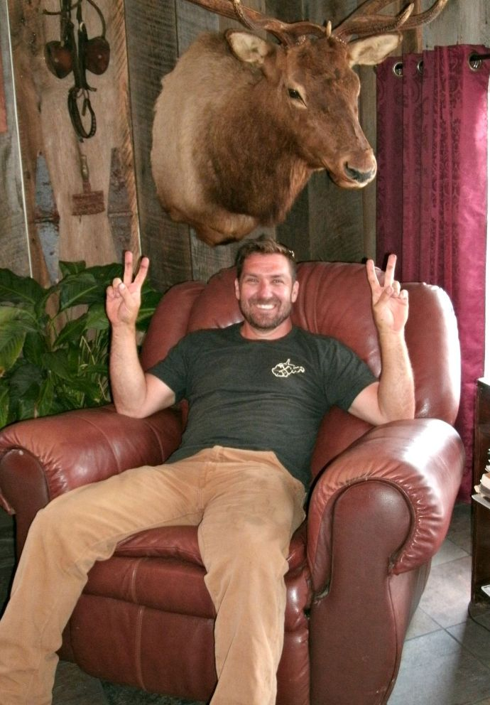 Mark Bowe hanging in the living room after shooting with the Barnwood builders