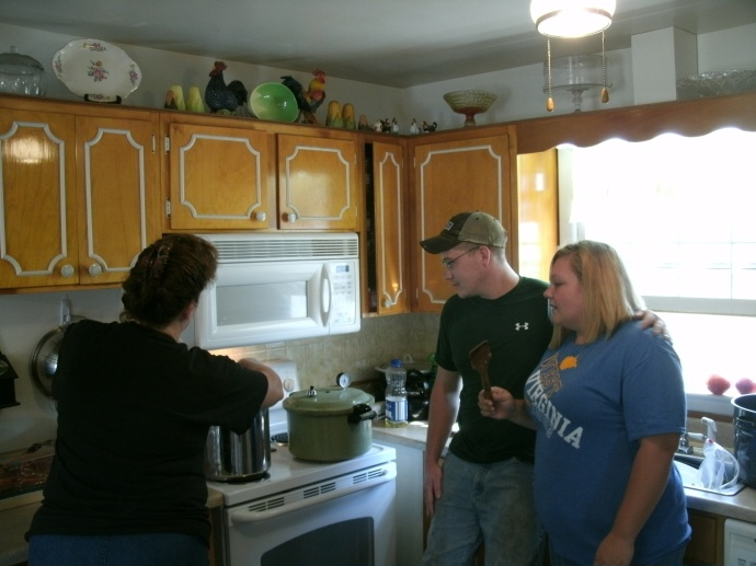 Cody,Jamie and I cooking and canning