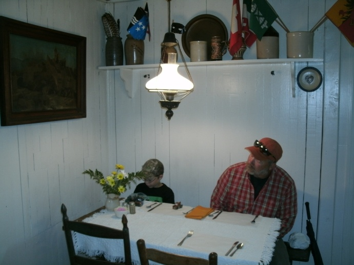 Tom and Christopher Powers looking over wall decor at the Hutte Haus Swiss restraunt, Helvetia WV