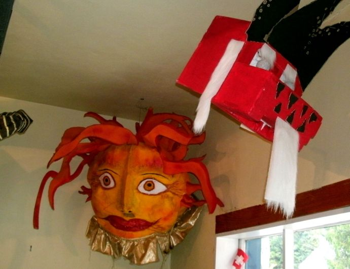 Sun and China dog masks from Helvetia WV