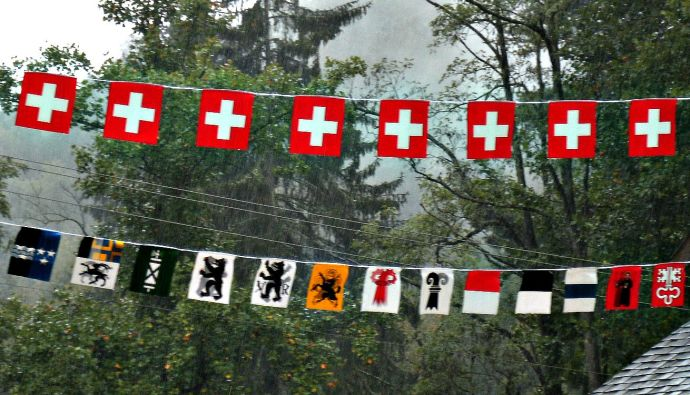Swiss family crests flying over main street in the rain