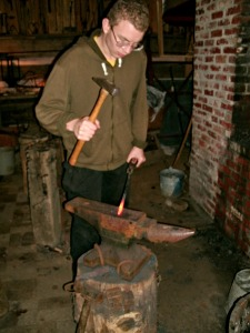 Blacksmith making a fireplace poker at Fort New Salem