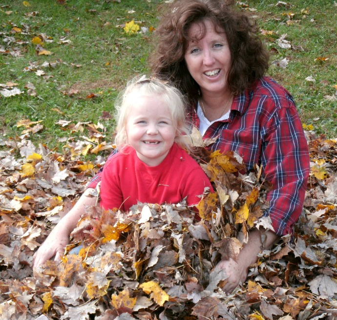 Paige and Jolynn Powers playing in fall leaves Oct 2015